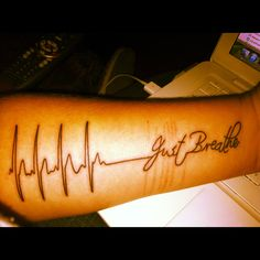 """My first tattoo is an EKG that says """"just breathe"""". It covers up the scars on my arm, an it's a constant reminder that I'm here for a reason, and everything will be ok if I just breathe"""