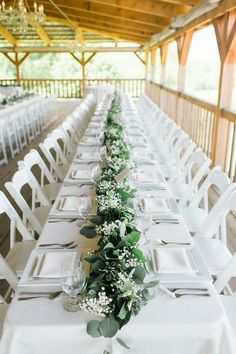 simple long white tables with greenery table runner -photo by Rachel Rowland
