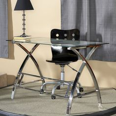 Crafted from strong chrome plated metal and durable glass, the top features a map design while the sides feature a unique 'X' pattern. Providing ample work space and design features like no other, this piece is sure to become a conversation starter.