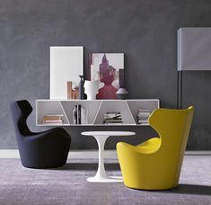 Scupltural forms: curves meet angles with the Piccola Papilio Armchair, shelving and table from B & B Italia http://www.campbellwatson.co.uk/superbasket/product/15945/Piccola+Papilio+Armchair+B%26B+Italia