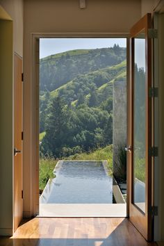 papress:  The main passage inside the house overlooks a water rill and the inland mountains toward the coastline of Point Reyes. From Landpr...
