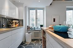 Small And Cosy Swedish Apartment Featuring A Brick Kitchen Bar