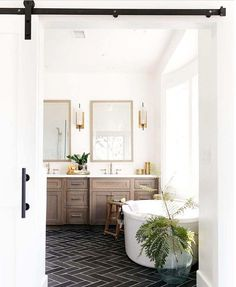"""One Kindesign on Instagram: """"This bathroom is simply breathtaking. With the exquisite herringbone tile pattern floor & beautiful wood vanity. What detail stands out to…"""""""