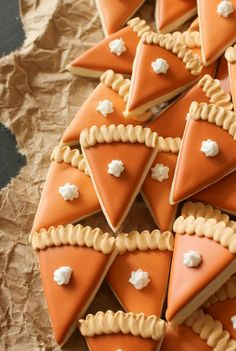 These cute mini pumpkin pie slice cookies are easy to snack on and will give your Thanksgiving dessert table some pizzazz. These cute mini pumpkin pie slice cookies are easy to snack on and will give your Thanksgiving dessert table some pizzazz. Thanksgiving Cookies, Fall Cookies, Thanksgiving Traditions, Pumpkin Cookies, Thanksgiving Decorations, Happy Thanksgiving, Thanksgiving Baking Ideas, Thanksgiving Deserts, Turkey Cookies