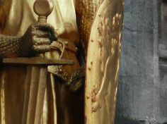 Gilded statue of Philip I, Count of Flanders on the façade of the Basilica of the Holy Blood, Bruges.