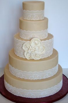 Edible lace with a custom rosette to match the bridal gown by The Butter End