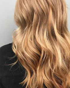 Bask in the warm glow of this strawberry blonde Aveda hair color by Aveda Artist Therese Snow at Casal's Dé Spa & Salon.