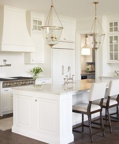Love: Layout, Cabinet Front, Cabinets to Ceiling, Range and Hood, Pendants, Countertops, Water thing over stove, faucet Like:Floor color, Pendants Dislike: cabinets on side of island, Lack of contrast in cabinets