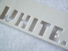 White, swing tag (photo by Neville Trickett)