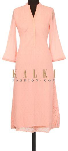 Peach kurti in fancy net only on Kalki
