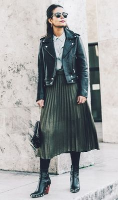 Collage Vintage edges up a pleated skirt with a moto jacket and booties.