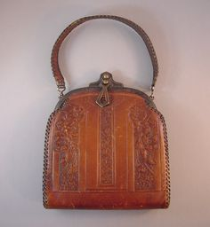 BOSCA BUILT Arts & Crafts leather purse with embossed floral from Morning Glory Jewelry. Buy now for $180.00