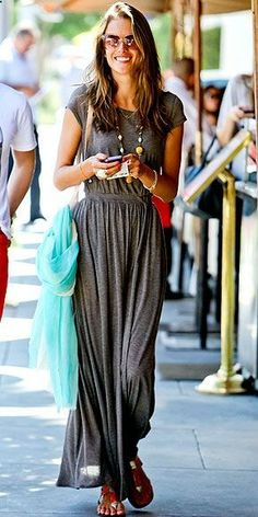 A soft t-shirt maxi dress with gladiator sandals and a long necklace create an easy, comfortable boho look.