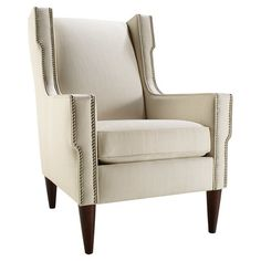Showcasing nailhead trim and tapered legs, this stately arm chair is an eye-catching addition to your sunroom reading nook or living room seating group....