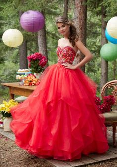 Morilee Prom 99015 is a Tulle and Organza Prom Gown with Floral Embroidered Sweetheart Bodice and Billowy Ruffled Skirt. Zipper Back Closure.