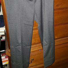Michael Kors Beautiful slacks Grey, with red pin stripes, cuffed at bottom. Absolutely beautiful, worn once only. Excellent condition. By Michael Kores size 4. Ankle length. Beautiful with pumps or your favorite sandals... Michael Kors Pants Ankle & Cropped
