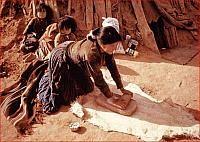 Navajo Woman Grinding Daily Corn Supply