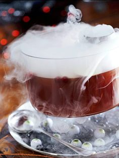 Ghoul's Punch. Recipe + more Halloween ideas: http://www.midwestliving.com/food/holiday/13-great-halloween-treat-recipes/page/3/0 Easy Alcoholic Punch Recipes, Non Alcoholic Punch, Haunted Halloween, Halloween Punch, Dry Ice, Orange Slices, Spices, Spice