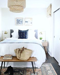 Pretty white bedroom. Love this vintage rug!