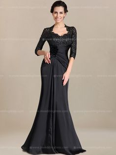 Lace and chiffon mother of the dress features 3/4 length sleeves and sweetheart neckline too add enough coverage. Asymmetrically ruching and floral details adorn the waist and a full length skirt draped elegantly to floor. Available in 60 colors, shown in Black.