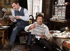 "Watson and Holmes perusing the headlines. (Robert Downey Jr. and Jude Law, ""Sherlock Holmes,"" 2009) lol robert"