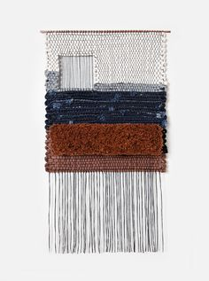Hand woven by Mimi Jung of Brook & Lyn. Commissioned by Levi's. Woven with denim scraps from the Levi's SF tailor shop.