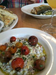 Charred Tomatoes and Field Pies with Creme Fraiche at The General Muir. Photo by Jennifer Booker.