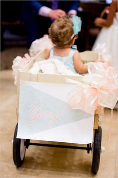 flower girl in a wagon…for the little ones you want in the wedding but don't quite know how they will cooperate!