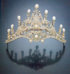 A very intricate diamond and baroque pearl tiara, 1890. Featuring mass foliate scrolls, with two pearls within, and topped with nine pearls. Sold via Sotheby's on 18 June 2002, for £20,315.