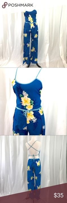 Vintage 1980s Aloha Hawaiian Open Back Jumpsuit S EUC. Vintage wrap jumpsuit. It ties at the back and has open legs that wrap on the sides. This an amazing one of a kind piece. Size Small. Urban Outfitters Pants Jumpsuits & Rompers