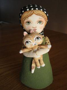 A little Babushka stump doll with her kitty.