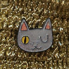 Enamel cat lapel pin - Cat pin  Created from my original winking cat face illustration, these super cute enamel pins are perfect for any jacket, bag, hat, shirt collar or anywhere else you feel like pinning them! This time Ive decided to go for extra GLITTER, with a clear, shiny resin on top. Its soooooo sparkly!  The super cute pins measure 2.5 x 2.5cm with a lapel pin back with a black rubber clutch. Show the world just how much you like CATS! Limited colour edition of 100! All of my items…