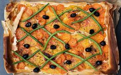 Tomato tart with French beans and rosemary.