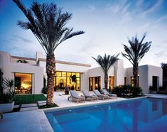 Furnishings from Plain Air overlook the pool, the work of Dunn's Designer Pools. The complex construction and renovation process required the expertise of builder Mark Hahn. Landscape designer Marcello Villano looked to desert natives to integrate the property into its surroundings.