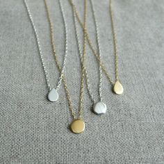 Love these delicate necklaces.  Good for layering....a technique I have yet to master.