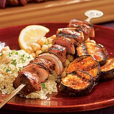 Here we combine baharat, a traditional Arabic spice blend, with olive oil, lemon, garlic, and tomato paste to make it into a savory rub to flavor lamb-and-vegetable kebabs.