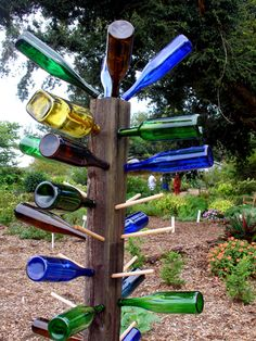Bottle trees. Simple beauty.  North,South,East,West - just follow the bottles....I love this!