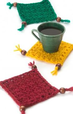 Best Free Crochet » Free Coaster Set Crochet Pattern from RedHeart.com #255 Coasters with Beads and Tassels ༺✿Teresa Restegui http://www.pinterest.com/teretegui/✿༻