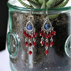 Perfect gift for any occasion!!! Birthdays, anniversaries, bridesmaid jewelry, you name it! Make sure you buy an extra pair because Im sure youd want to keep one for yourself!  Beautifully made dangle earrings made with cats eye glass beads and red diamond shaped glass beads. Feel elegantly classy every time you wear these earrings with your favorite outfit!  Please contact me for custom and multiple orders.