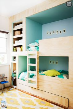 Custom-built bunk beds are perfect for a boys' room. We love the combination of light timber and bright walls.