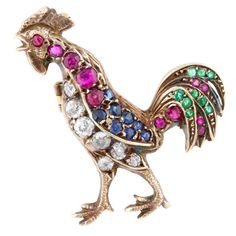 A French gold, silver, ruby, sapphire, emerald and diamond brooch in the form of a rooster/cock, symbol of France. (1stdibs.com)