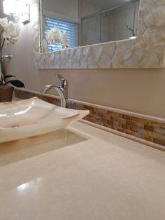 #Bathroom #Remodel - Silestone quartz countertops with a vessel sink and glass mosaic backsplash.