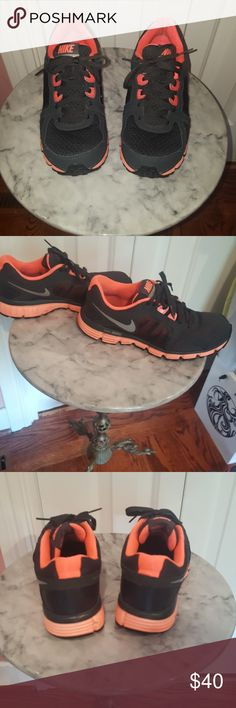 Nike shoes Black nike shoes with orange accents. Used with wear throughout but in good condition. Nike Shoes Athletic Shoes