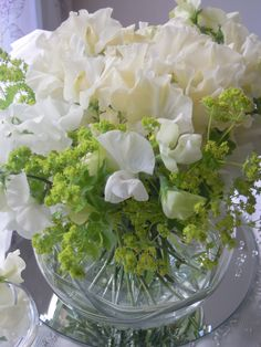 Table decoration of ivory Sweetpeas and Alchemilla Mollis in a goldfish bowl with china grass swirling & goldfish bowl with flowers | Flowers | Pinterest | Goldfish bowl and ...