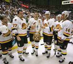 Canuck Captain Trevor Linden and friends in 1994 after winning the Western Conference and the Campbell trophy. Vancouver overcame a deficit against the Calgary Flames, winning the final 3 games in overtime, with game 7 ending in double overtime. Hockey Teams, Hockey Players, Western Conference, Vancouver Canucks, Sports Figures, National Hockey League, Stanley Cup, Calgary, Nhl