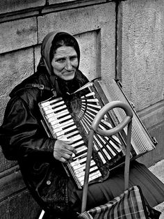 Woman on a bridge with her accordion