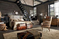 Great industrial space with personality. Love the vintage suitcases and stairs.