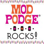 This gal's site has tons of ideas for mod podge crafts with step-by-step videos on how to do things easily.
