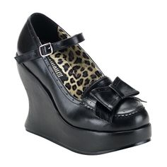Platform wedge shoes with pinking detail, adjustable Mary Jane strap, and adorable bow accent