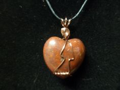 This is a Red Jasper Heart Wrap done with Antique Copper Non-tarnish wire. The Necklace is about 2 inches from the base of the Heart to the top of the wire cord loop. Comes with cord and mesh bag to protect the necklace, to be worn as a necklace.